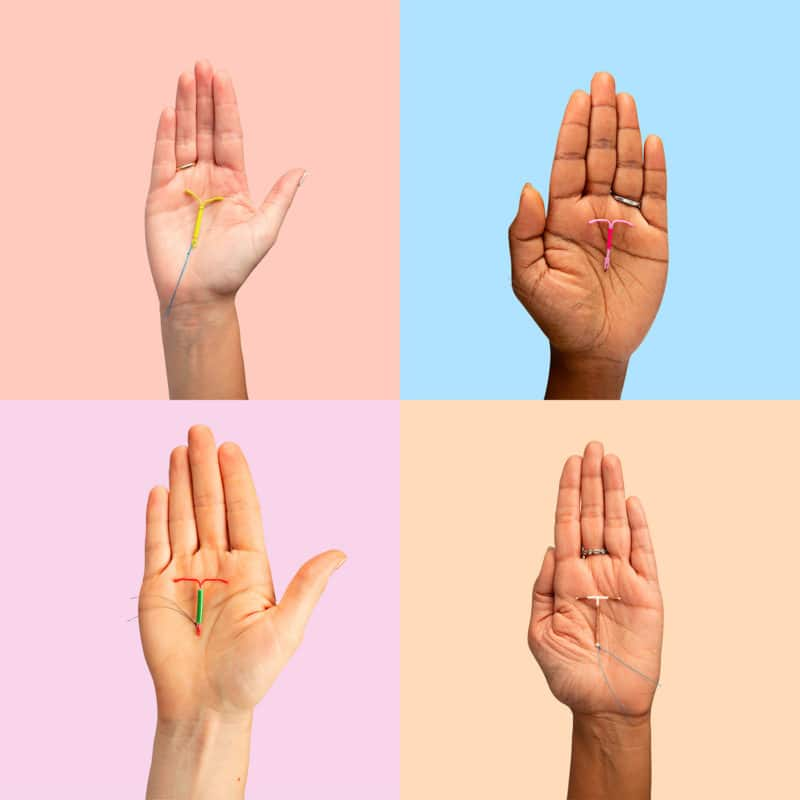Photo of four IUDs in four hands